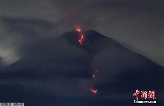 Volcanic materials spew from Mount Semeru in East Java, Indonesia